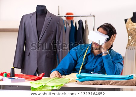 Tailor working in VR glasses Stock photo © dash