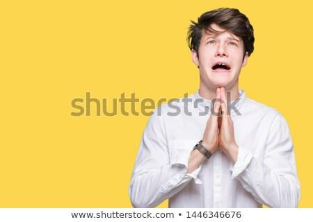 Preocupado oração branco telefone triste Foto stock © wavebreak_media