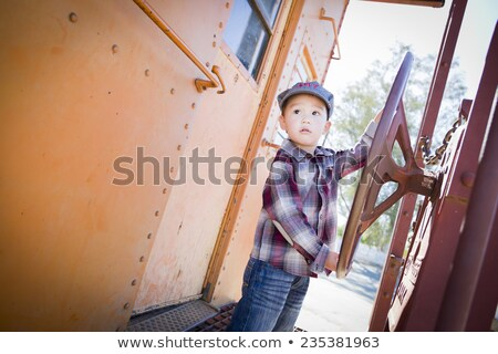 Cute Young Chinese and Caucasian Boy Having Fun Outdoors Stock photo © feverpitch