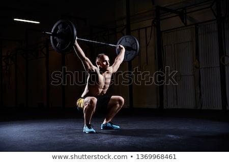 Gömleksiz adam halter crossfit spor salonu Stok fotoğraf © wavebreak_media