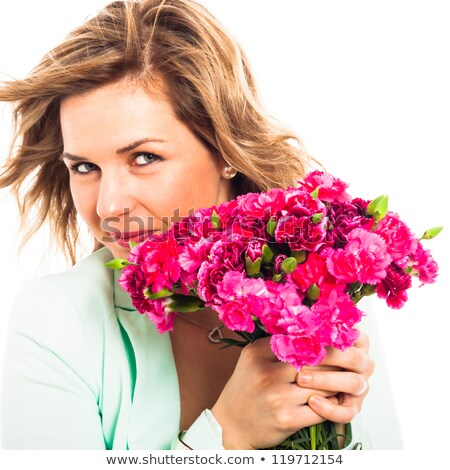 Attractive woman with bunch of pink cloves Stock photo © LightFieldStudios