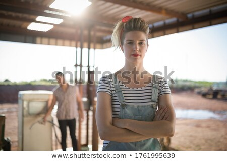 Woman standing with arms crossed at petrol pump station Stock photo © wavebreak_media