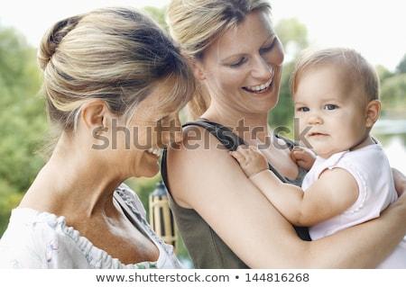 nagymama · anya · baba · szeretet · mosolyog · néz - stock fotó © IS2