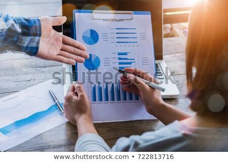 Afrikaanse zakenman tonen financiële diagram zwarte Stockfoto © studioworkstock