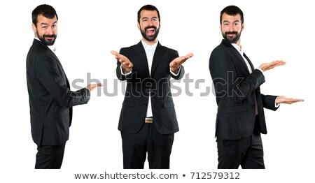 portré · jóképű · üzletember · mutat · valami · fehér - stock fotó © feedough