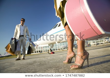 Woman standing next to private jet. Stock photo © IS2