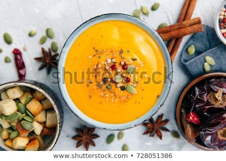 Pumpkin soup in bowl served with bread Stock photo © dash