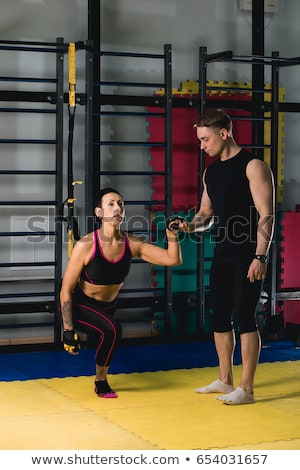 Woman make sport exercises in gym. Stock photo © deandrobot