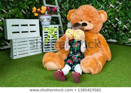 Stock photo: Two cute girls hugging a huge teddy bear