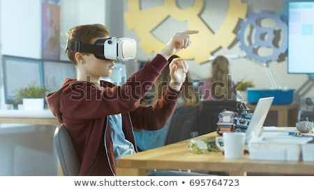 boy wearing virtual reality goggles Stock photo © Lopolo
