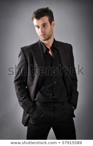Stockfoto: Portret · vrolijk · jonge · man · zwart · pak · boeg