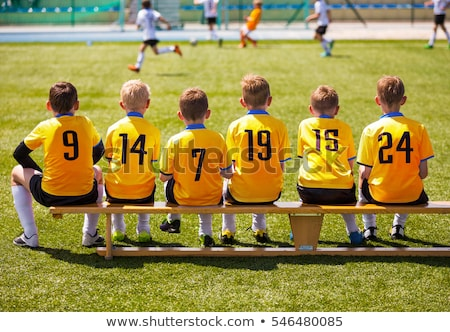Young Football Players. Young Soccer Team Sitting on Bench Stock photo © matimix