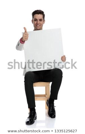 Sitzend Geschäftsmann halten Bord Zeichen Stock foto © feedough