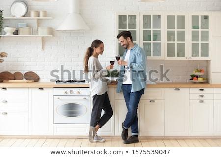 Smiling lovers drinking white wine in the kitchen Stock photo © ruslanshramko