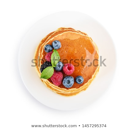 pancakes with raspberries and maple syrup stock photo © loopall