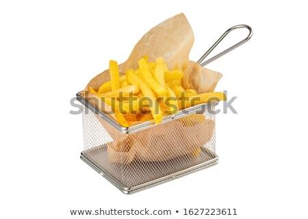 French fries served in metallic mesh basket Stock photo © lightkeeper