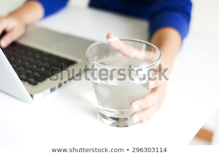 Computer On Desk With Glass Of Water Stock photo © AndreyPopov