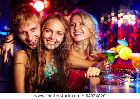 Company of People Clubbing and Partying Drinking Stock photo © robuart