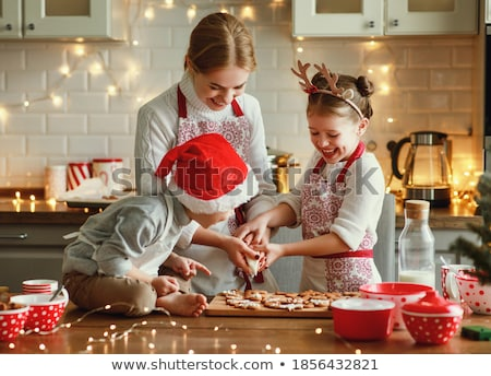Happy young woman and little boy in aprons preparing pastry in the kitchen Stock photo © pressmaster