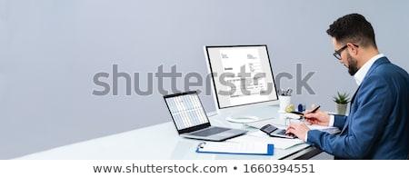 Comptable facture ordinateur bureau homme Photo stock © AndreyPopov
