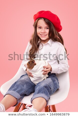 Vertical portrait of delightful small female child in white clot Stock photo © vkstudio