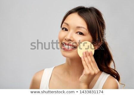 Asya kadın temizlik yüz sünger güzellik Stok fotoğraf © dolgachov