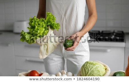 Avocado in a reusable bag in female hands. Zero waste concept, plastic free concept. Healthy clean e Stock photo © galitskaya