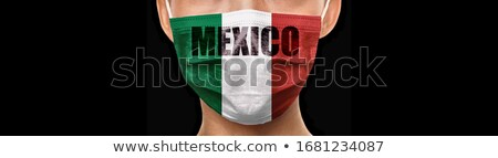 Mexico flag Coronavirus design on mask doctor wearing preventive COVID-19 protection with text panor Stock photo © Maridav
