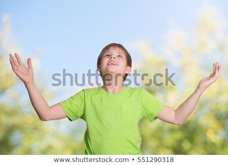 happy christian kids arms raised in joy and faith Stock photo © godfer