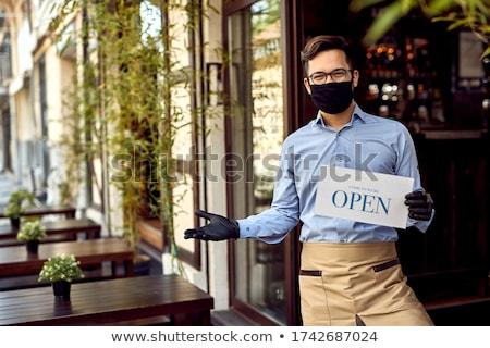 kelner · uśmiechnięty · przystojny · odizolowany · biały · człowiek - zdjęcia stock © Kurhan
