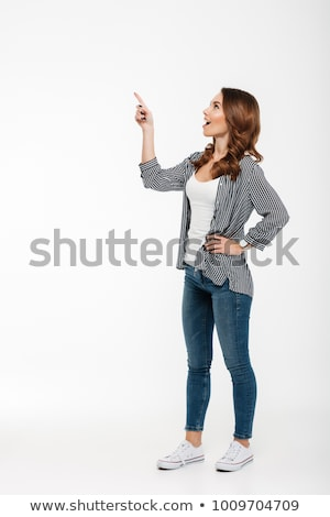 Young pretty woman standing and looking up Stock photo © lovleah