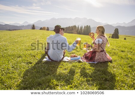 happy bavarian dressed girl with beer and pretzel stock photo © rob_stark