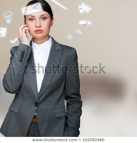 Zdjęcia stock: A Business Woman With Icons Of Her Affairs Flying Around Her He