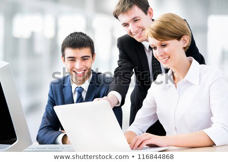 Portrait of a team of business people confidently sitting togeth Stock photo © HASLOO