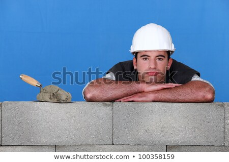 bricklayer with trowel head resting on arms Stock photo © photography33