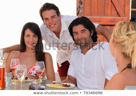 30 years old couple and a 20 years old man behind them posing outside at lunch time, summer scene Stock photo © photography33