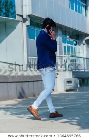 empresario · maletín · fuera · oficina · sonriendo - foto stock © photography33