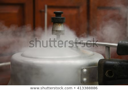 Steam escaping from new pressure cooker pot Stock photo © backyardproductions
