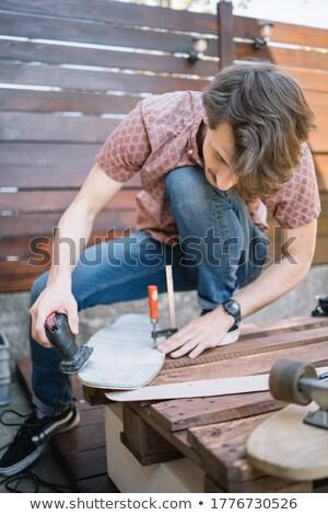 Portrait of a handyman holding a sander Stock photo © photography33