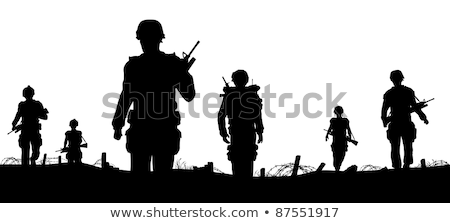 Silhouette armée soldat marche collines coucher du soleil Photo stock © experimental