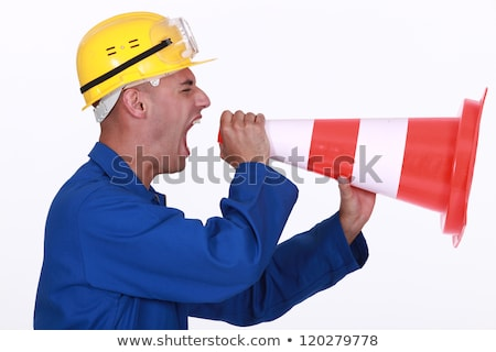 Angry tradesman yelling into a megaphone Stock photo © photography33