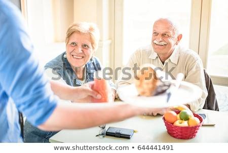 Waiter serving a senior couple Stock photo © photography33
