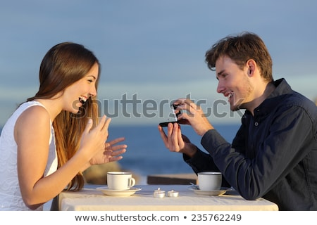 Man offering woman gift in restaurant Stock photo © photography33