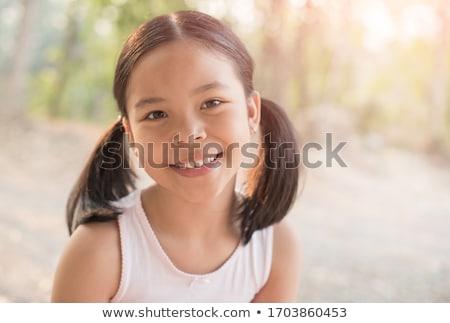 sorridente · bonitinho · menina · olhando · câmera · bastante - foto stock © dash