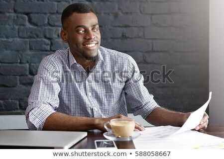 Handsome man doing his paperwork Stock photo © photography33