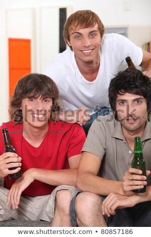 Três 18 anos velho meninos potável Foto stock © photography33