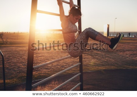 Fit young woman practicing abdominal exercises Stock photo © stryjek