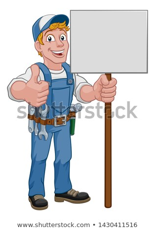 Plumber holding wrench and clip board Stock photo © photography33