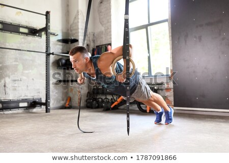 the gymnast on rings Stock photo © karelin721