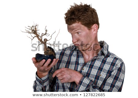 Electrocuted man holding a plant Stock photo © photography33